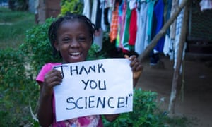 Child holding up a sign saying thank you for the Ebola vaccine