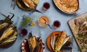 a feast of barbecued steak with grilled corn and potato gratin