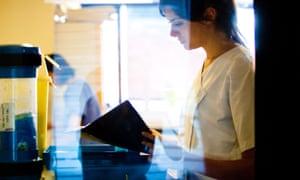 a nurse consults patient notes.