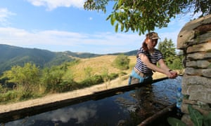 Maddy drinking at one of the many springs in Bulgaria's Rhodope mountains.