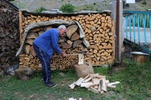 An old man chopping firewood for in Trigrad.
