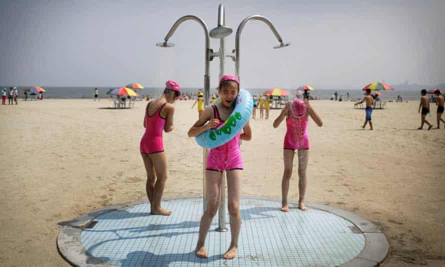 North Korean girls stand under a shower at the Songdowon International Children's Camp in Wonsan, North Korea.