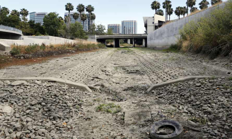 The dried up bed of the Guadalupe River in San Jose, California is one of the casualties of global warming.