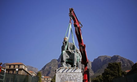 A crane removes the statue of British colonialist Cecil John Rhodes at the Cape Town University following protests by the student body.