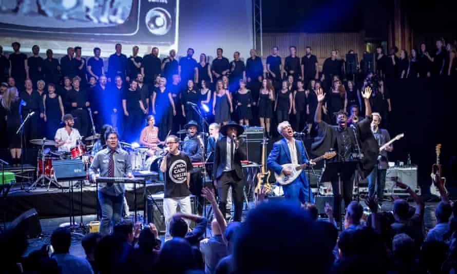 'Uplifting chorus': the full Atomic Bomb! ensemble take the festival hall stage.