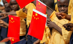Liberian children with Chinese flags welcome a visit by arrival of China's President Hu Jintao.