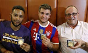 Anthony Sadler, from Pittsburg, California, Alek Skarlatos, from Roseburg, Oregon, and Chris Norman, a British man living in France – three of the four men who are believed to have helped disarm the attacker – pose with medals they received for their bravery at a restaurant in Arras
