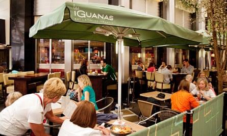 people eating a meal at Las Iguanas latin food restaurant, O2 arena, London UK
