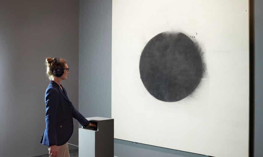 The haptic device in front of John Latham's painting Full Stop