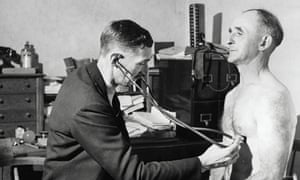 A GP listening to a patient's chest in 1948. Today GP vacancies remain unfilled and older doctors are retiring early. Photograph: Popperfoto/Popperfoto/Getty Images