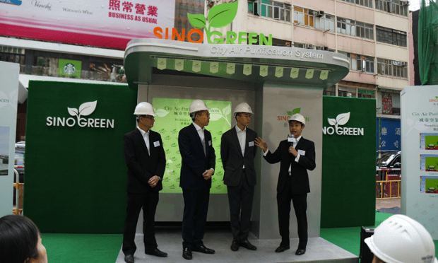Dr. Jimmy Tong (right) and colleagues from Sino Group.  From right to left, Mr. David Ng, Executive Assistant to Chairman, Mr. Daryl Ng, Executive Director, and Mr. Vincent Lo, General Manager, showcasing a patent-pending clean-air stand in Hong Kong.