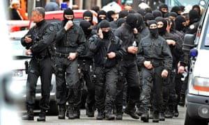 Members of the French special police forces unit after breaking into the besieged flat of al-Qaida militant Mohamed Merah in Toulouse in March 2012.
