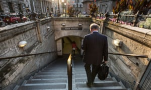 A City gent heads for the Tube.