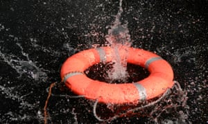 Life preserver floating on water