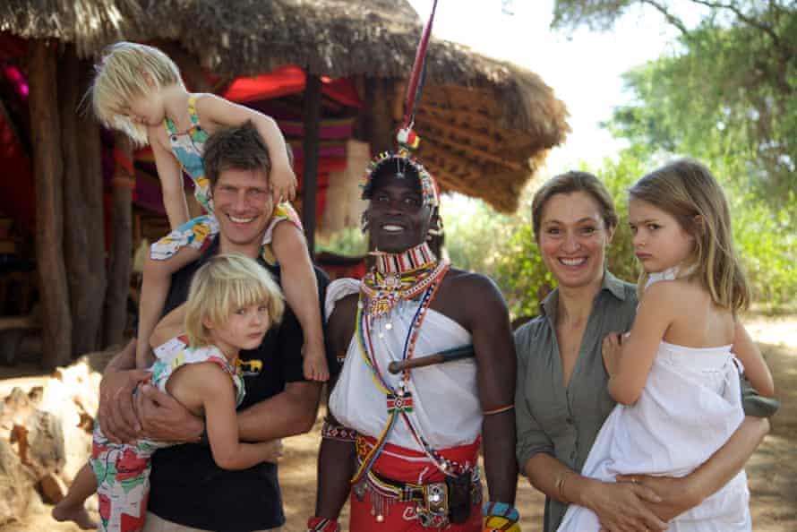 Frank, Saba, their daughters and Mporian, a warrior who babysits the children, at Elephant Watch camp, Samburu national reserve, Kenya.