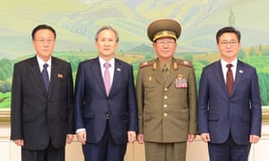 Left to right: North Korea's Kim Yang-gon, South Korea's Kim Kwan-jin, North Korea's Hwang Pyong-so and South Korea's Hong Yong-pyo pose for a photo after their talks at the DMZ.