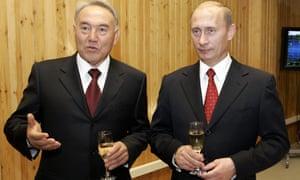 Russian president Vladimir Putin (right) and Kazakhstan's president Nazarbayev at Baikonur.