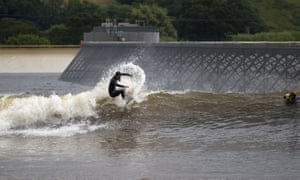 A surfer experiences at Surf Snowdonia, Wales