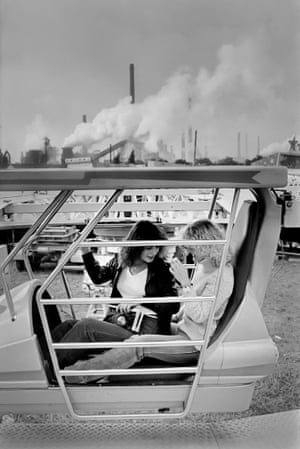 Fun fair in front of August Thyssen steel plant in Bruckhausen, Beeck, Duisburg, West Germany, 1979