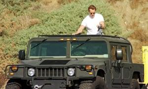 Arnold Schwarzenegger with his Humvee on Malibu beach in 1999.
