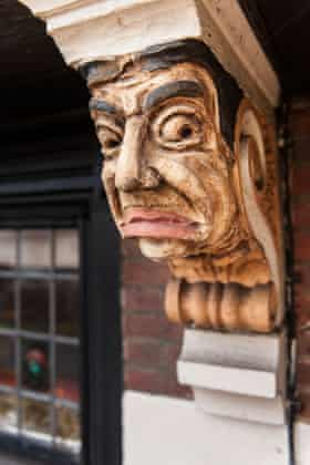 Detail of the carved corbel on the Station, Surrey, built 1935-6 by Truman's Brewery.