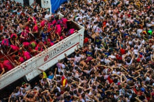 Revellers enjoy the atmosphere in tomato pulp while participating the annual Tomatina festival on August 26, 2015 in Bunol, Spain. An estimated 22,000 people threw 150 tons of ripe tomatoes in the world's biggest tomato fight held annually in this Spanish Mediterranean town.
