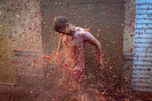 A reveller is pelted with tomato pulp