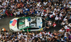 The Google Street View car drives through revellers shortly before it is pelted with tomatoes.