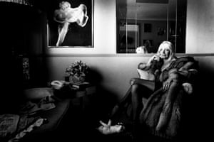 Maureen Flanagan, glamour model since the seventies and old friend of the Firm, sits in her living room in Holloway, North London