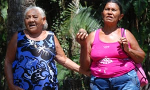 Francisca Rodrigues dos Santos (on the left), from Piaui, singing with a fellow quebradeira holding a babassu fruit.