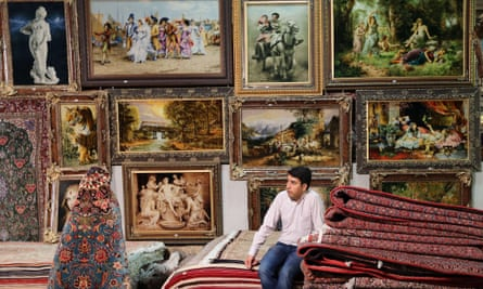 An Iranian vendor waits for clients at Iran's international hand-woven carpet exhibition in Tehran.