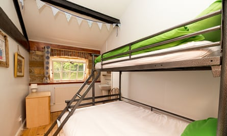 A family room with double bed with a single above – a sort of three-man bunkbed – at YHA Boggle Hole.