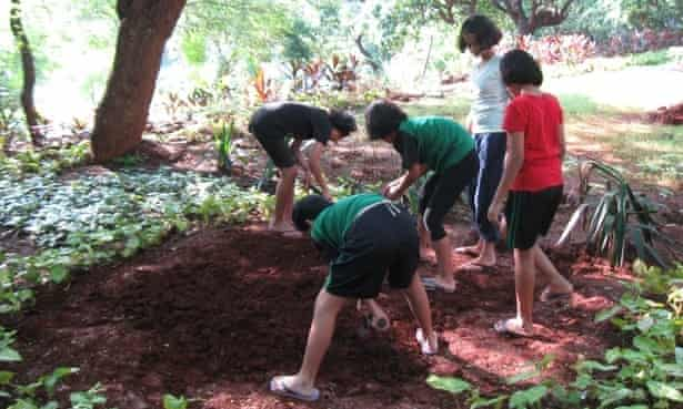 School girls in Mumbai creating a bed to grow vegetables