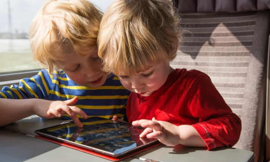 Two children using an iPad