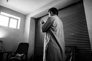 Arab Shah praying in his office