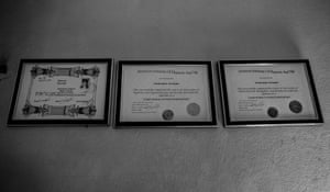 Shah's certificates are displayed in his office