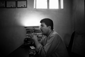 Arab Shah sits in his office.