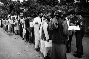 Every weekday morning hundreds of people queue in front of the passport office in Kabul