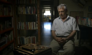 Israeli writer and six-day war veteran Amos Oz listens to a tape of his earlier self in the documentary Censored Voices.