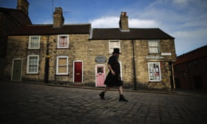 A steampunk enthusiast walks the cobbled streets of Lincoln during the Asylum Steampunk festival in Lincoln