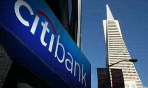 A sign is displayed on the exterior of a Citibank branch office in San Francisco, California.  A division of Citibank has published a report finding that slowing global warming would produce a positive return on investment.