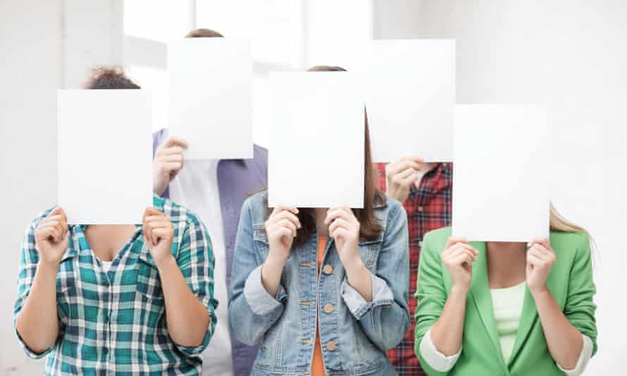 people covering their faces with sheets of paper