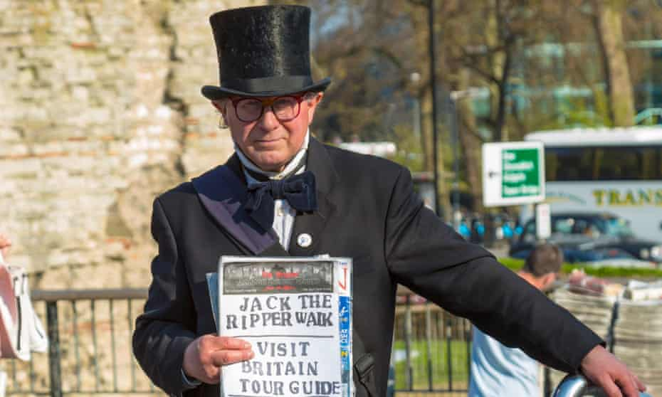 A Jack the Ripper tour guide in east London. The murders of five women working as prostitutes in 1888 has been turned into a tourist attraction.