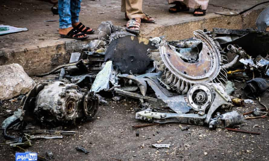 A photo provided by the Syrian anti-government activist group Ariha Today shows parts of a destroyed government warplane that crashed in  Ariha.