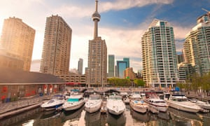 The new Harbourfront development in Toronto with boats against a backdrop of the city skyline