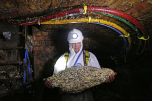 A 'flusher', or trunk sewer technician, holds a fatberg.
