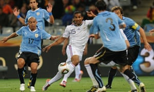 France's midfielder Florent Malouda (centre) Uruguay's Egidio Arevalo (left) and Diego Lugano (right) during their first round match at the 2010 World Cup.
