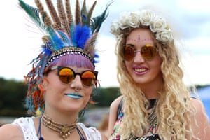 Ashton Brown, left and Alice Varney, right wear colourful attire at Leeds festival.
