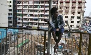 A Burmese man sits near a construction site in Rangoon. The new regulation means the minimum monthly pay for workers would be about $67, based on a six-day week.