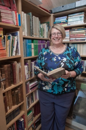 Author Louise Allen in her shed with her historical book collection.